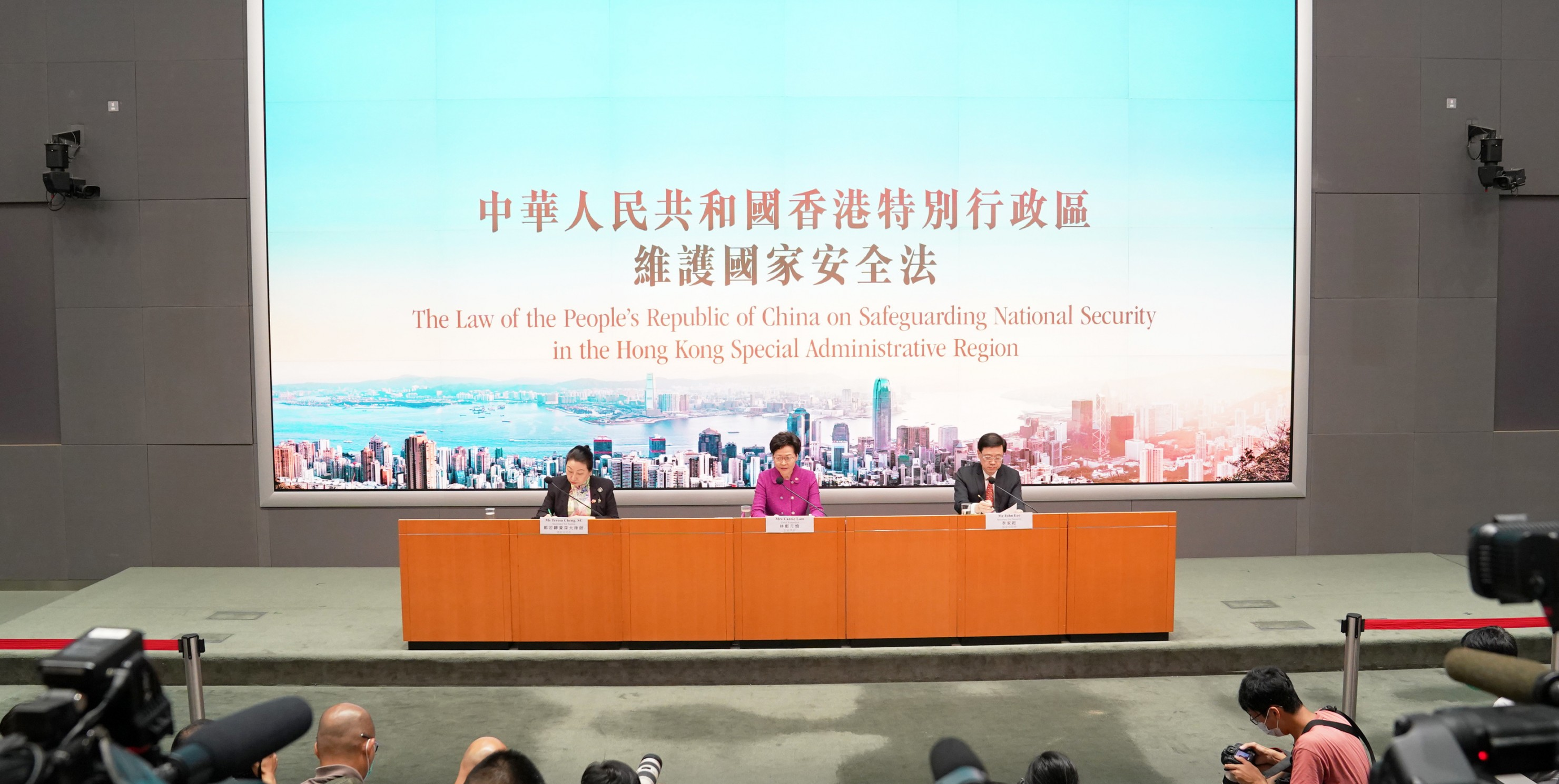 Chief Executive Carrie Lam (C), the Secretary for Justice Teresa Cheng (L) and the HKSAR government's Secretary for Security John Lee Ka-chiu attend a press conference in Hong Kong, July 1 2020
