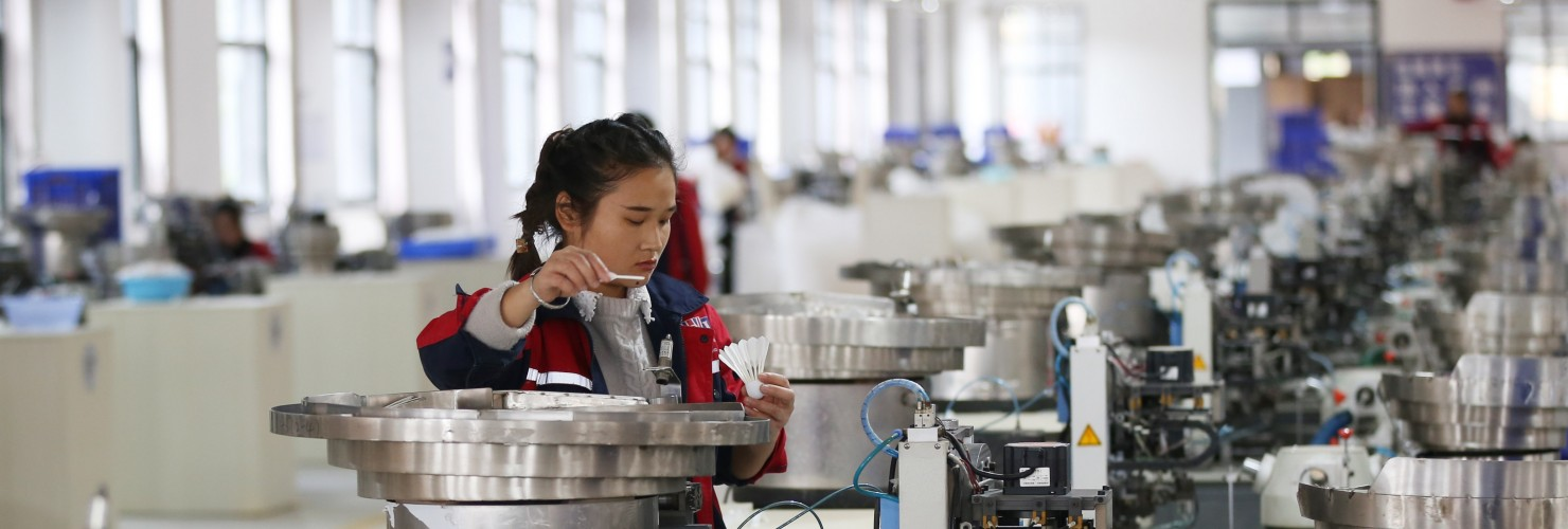 A worker assembles a badminton ball in a production base in Jinping County, Guizhou Province.