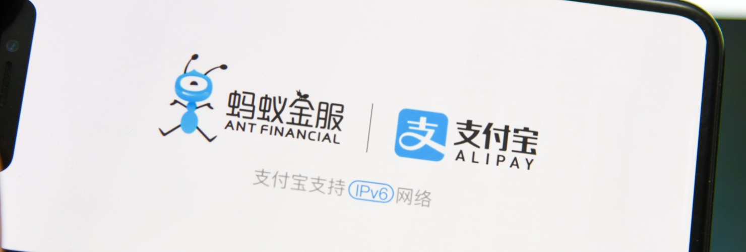 Logos of Alibay and Ant Financial appear on a smartphone screen