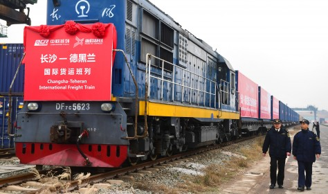 Chinese customs officers check a freight train of China Railway Express running from Changsha to Tehran.