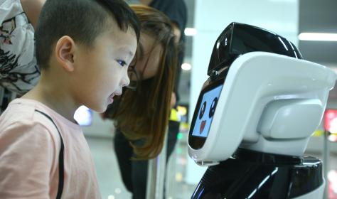 Chinese boy and robot