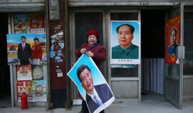 Portraits of Mao and Xi on posters