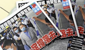 Newspapers of Hong Kong's Apple Daily are pictured at a stand in Hong Kong