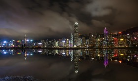 Night view of skyscrapers and high-rise buildings in Central along the Victoria Harbor in Hong Kong