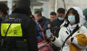 Chinese Show Security Health Status on Smarphone App in Beijing, China