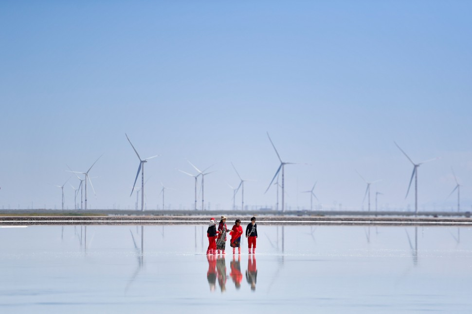 People in front of wind turbine